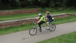Pilot Oliver and goalballer Anthony (from SY) riding a tandem along a bike path on the Goalball UK Coast to Coast Challenge (2015)
