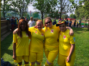 Reanne Racktoo stood in a group photo in yellow football kit at the England at the 1st ever IBSA Women's Blind Football tournament in Austria in 2017.