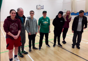 Reanne Racktoo stood in a group photo at a blackburn Goalball club training session wearing a Manchester United top.