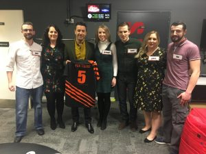 Fen Tigers team on Gino D/Acampo's Win Your Wish List holding a Fen Tigers shirt