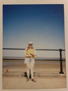 Faith Johnson stood in front of bright sunny sky at the beach.