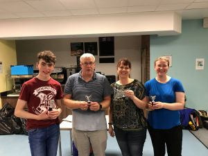 Lorna Morisset stood with 3 people who are all holding small trophies after a fun activities evening at the Home Nations tournament in 2018.