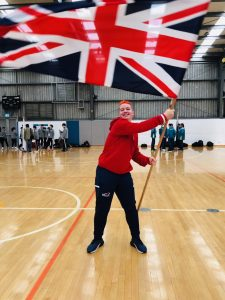 Meme Robertson waiving the Great Britain flag at the 2019 Under 19 World Championships!
