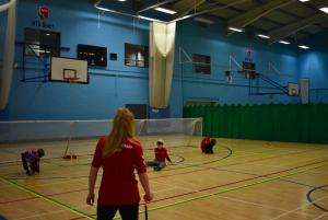 Ruby Hudson looking on officiating a goalball game.