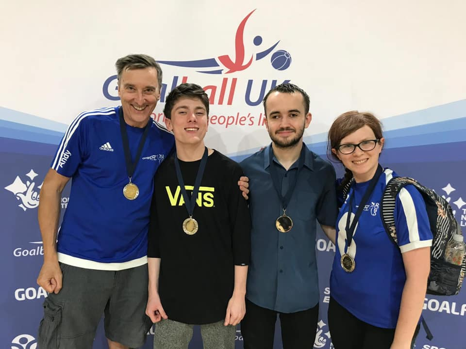 Group picture of Cambridge Dons at a tournament with their medals!