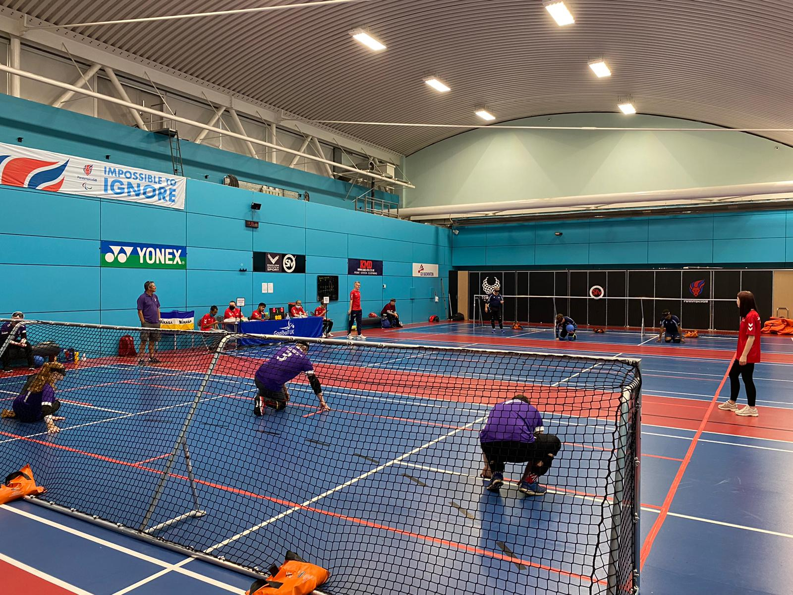 Picture taken behind the goal of Scarborough Panthers in purple jerseys against Mersey Sharks on the other side of the court.