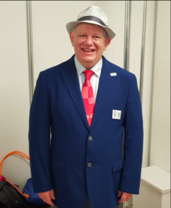 Robert Avery stood smiling in his Tokyo 2020 formal outfit.