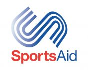 SportsAid logo with the word sport in red and aid in blue with an S above in the design of a running track.